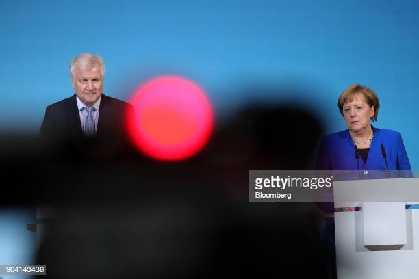 Horst Seehofer leader of the Christian Social Union party left and Angela Merkel Germany's chancellor look on during a news conference following...
