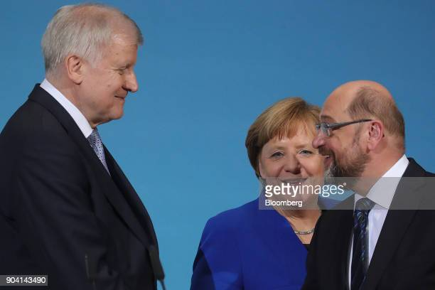 Horst Seehofer leader of the Christian Social Union party left Angela Merkel Germany's chancellor center and Martin Schulz leader of the Social...