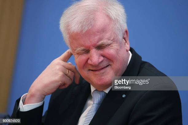 Horst Seehofer leader of the Christian Social Union party scratches his ear during a news conference ahead of the signing of a government coalition...