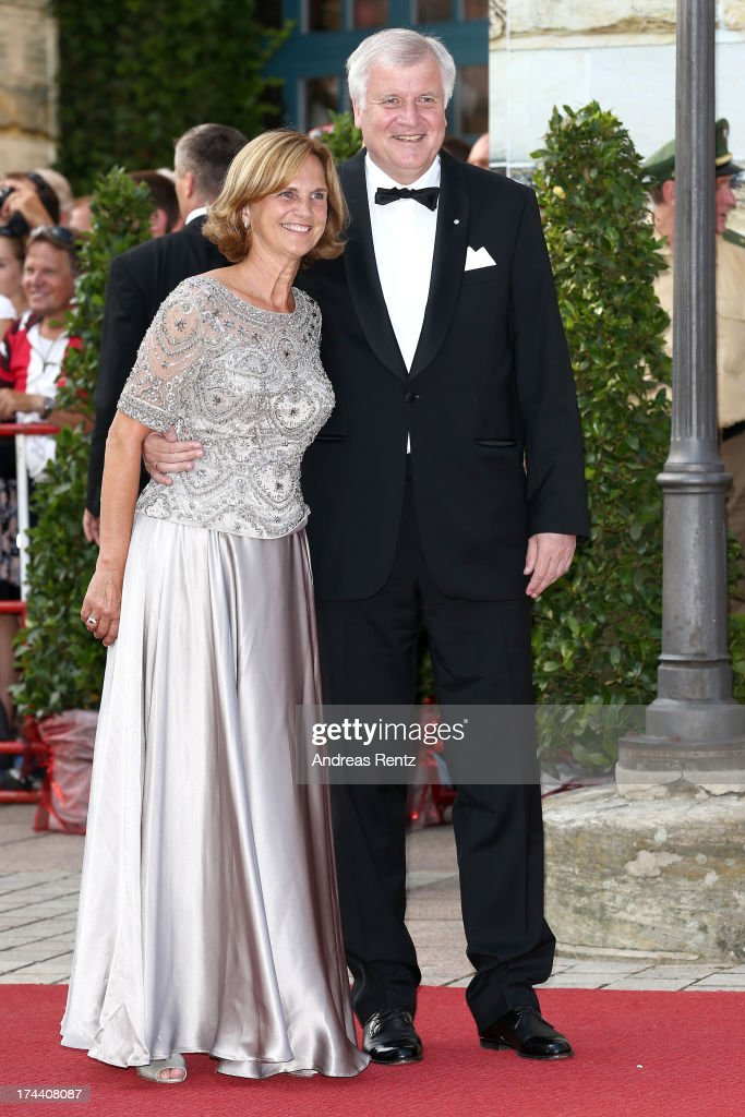 Horst Seehofer (L), Minister-President of Bavaria, and his wife Karin Seehofer attend Bayreuth Festival Opening 2013 on July 25, 2013 in Bayreuth, Germany.