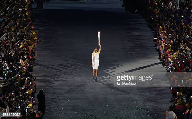 Hortencia Marcari carries the Olympic flame through the stadium during The 2016 Summer Olympics Opening Ceremony at Maracana Stadium on August 5 2016...