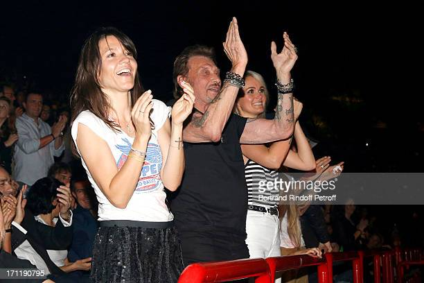 Hortense d'Esteve Singer Johnny Hallyday and his wife Laeticia Hallyday in the stand while Patrick Bruel performs at his last concert in Paris held...