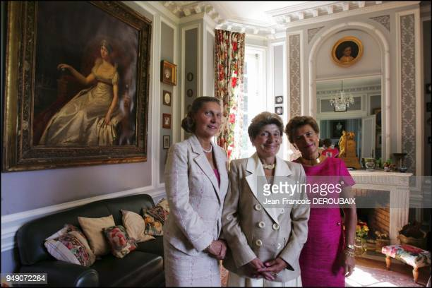 Hortense Josephine and Marie Tascher de la Pagerie empress Josephine's last descendants in their country estate pose in front of a beautiful portrait...
