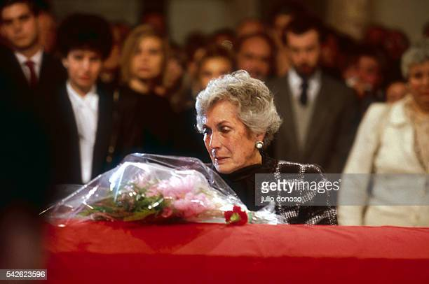 Hortensia Bussi de Allende widow of deposed President Salvador Allende places flowers on her husband's coffin during the funeral service on September...