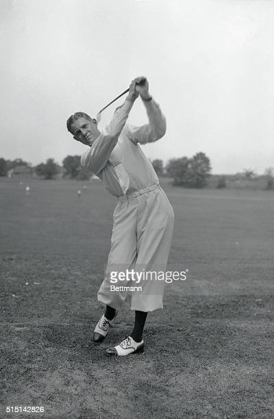 Horton Smith swinging his club during the National Open Golf tournament.