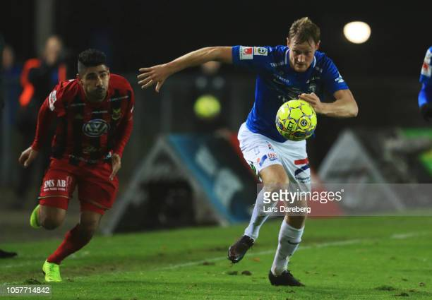 Hosam Aiesh of Ostersunds FK and Anton Tideman of Trelleborgs FF competes for the ball during the Allsvenskan match between Trelleborgs FF and...