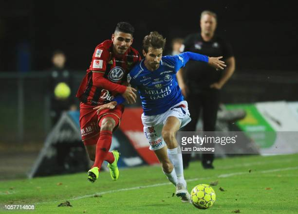Hosam Aiesh of Ostersunds FK and Sebastian Ohlsson of Trelleborgs FF competes for the ball during the Allsvenskan match between Trelleborgs FF and...