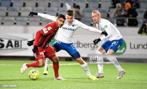 Hosam Aiesh of Ostersunds FK and Simon Skrabb of IFK Norrkoping competes for the ball during the Allsvenskan match between IFK Norrkoping and...
