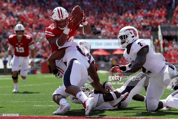 Hosea Barnwell V of the Florida Atlantic Owls tackles Jonathan Taylor of the Wisconsin Badgers short of the goal line in the second quarter at Camp...