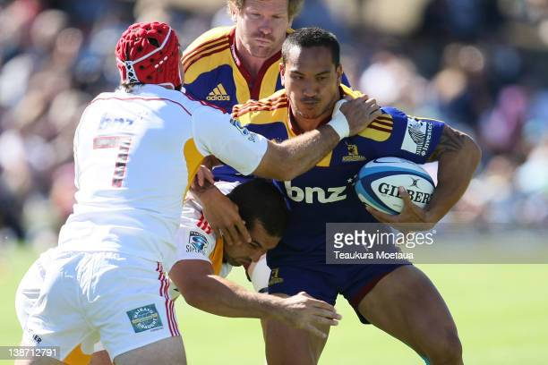 Hosea Gear is tackled during the Super Rugby trial match between the Chiefs and the Highlanders at Queenstown Recreation Ground on February 11 2012...