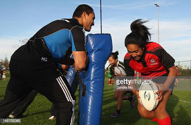 Hosea Gear of the All Blacks coaches a select group of secondary school girls rugby players during a surprise visit by the All Blacks at Onehunga...