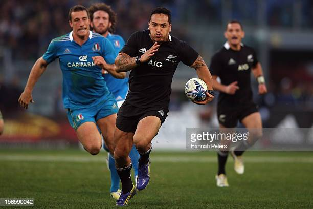 Hosea Gear of the All Blacks makes a break during the international rugby match between Italy and New Zealand at Stadio Olimpico on November 17 2012...