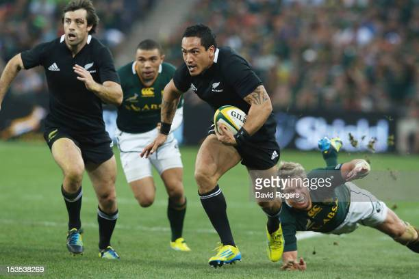 Hosea Gear of the All Blacks moves away from Jean de Villiers during the Rugby Championship match between South Africa Springboks and the New Zealand...