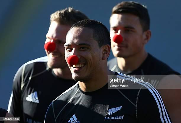 Hosea Gear of the All Blacks wears a red nose as part of a charity fund raiser during a New Zealand All Blacks captain's run at Eden Park on August...