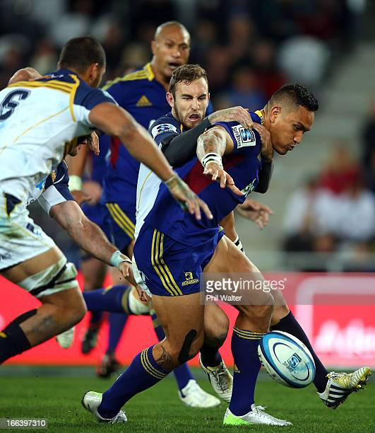 Hosea Gear of the Brumbies fumbles the ball during the round nine Super Rugby match between the Highlanders and the Brumbies at the Forsyth Barr...