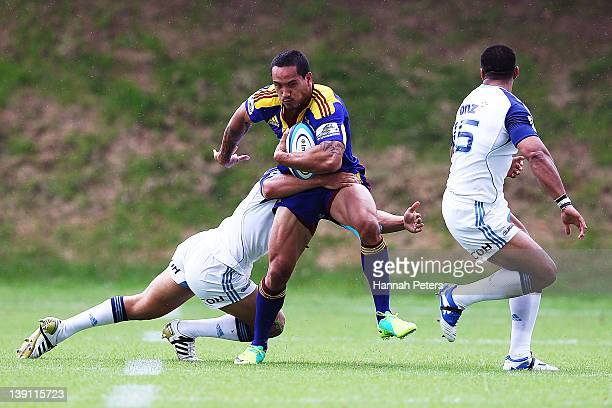 Hosea Gear of the Highlanders makes a break during the Super Rugby trial match between the Blues and the Highlanders at Unitec on February 17 2012 in...