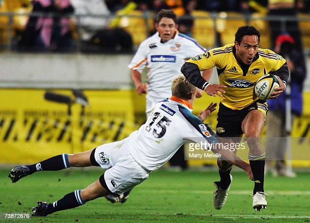 Hosea Gear of the Hurricanes gets tackled by Philip Burger of the Cheetahs during the round 11 Super 14 match between the Hurricanes and the Cheetahs...
