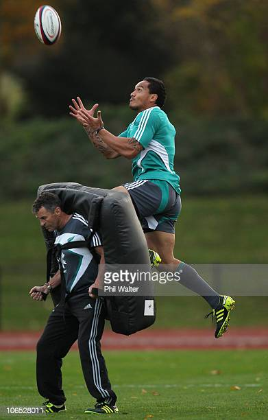 Hosea Gear of the New Zealand All Blacks leaps for the ball over assistant coach Wayne Smith during a New Zealand All Blacks training session at...