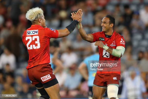 Hosea Saumaki of the Sunwolves and team mate Semisi Masirewa hug after the win over the Waratahs during the round seven Super Rugby match between the...