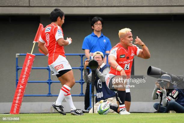Hosea Saumaki of the Sunwolves celebrates scoring his side's third try with his team mate Yutaka Nagare during the Super Rugby match between...