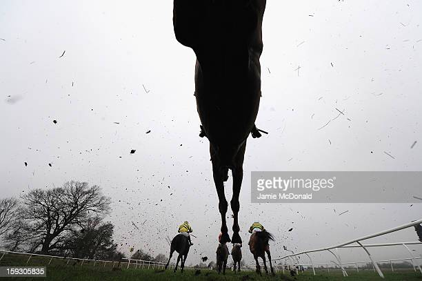 Hoses and riders over the ditch during the Connoll's Red Mills Horescare Cubes Novices Steeple Chase at Huntingdon Racecourse on January 11 2013 in...