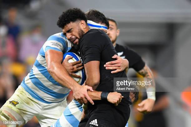 Hoskins Sotutu of the All Blacks is tackled during The Rugby Championship match between the Argentina Pumas and the New Zealand All Blacks at Suncorp...