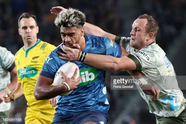 Hoskins Sotutu of the Blue is tackled by Hugh Renton of the Highlanders during the Super Rugby Trans-Tasman Final match between the Blues and the...