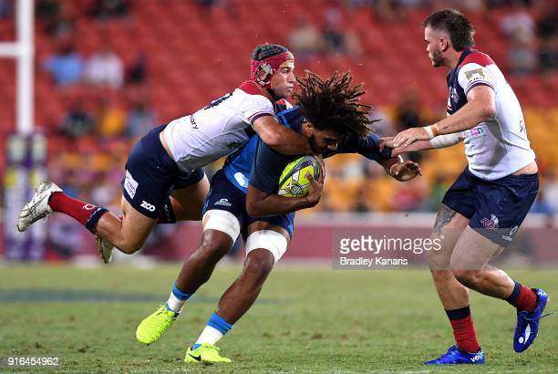 Hoskins Sotutu of the Blues takes on the defence during the 2018 Global Tens match between the Blues and Queensland Reds at Suncorp Stadium on...