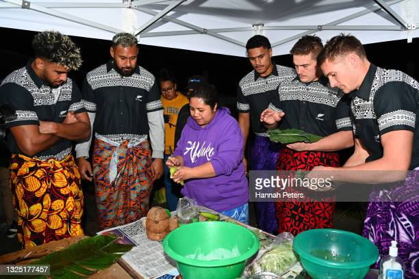 Hoskins Sotutu, Patrick Tuipulotu, Tupou Vaa'i, Ethan de Groot and George Bridge of the All Blacks help prepare a Samoan Umu at Fetu Pupula Place on...