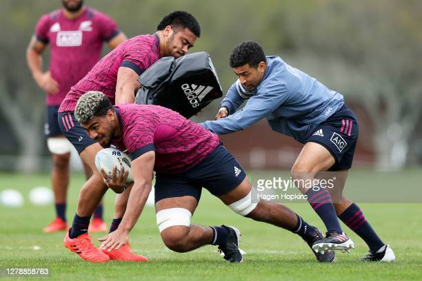 Hoskins Sotutu runs at Asafo Aumua with Richie Mo'unga in support during a New Zealand All Blacks training session at Hutt Recreation Ground on...