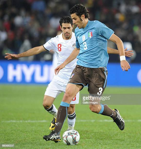 Hosni Abd Rabbou of Egypt and 18 of Italy battle during the 2009 Confederations Cup match between Egypt and Italy at CocaCola Stadium on June 18 2009...