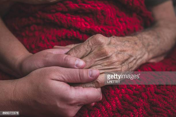 hospice nurse visiting an elderly male patient - hospice stock pictures, royalty-free photos & images