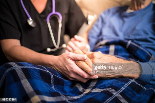 hospice nurse visiting an elderly male patient - care stock pictures, royalty-free photos & images