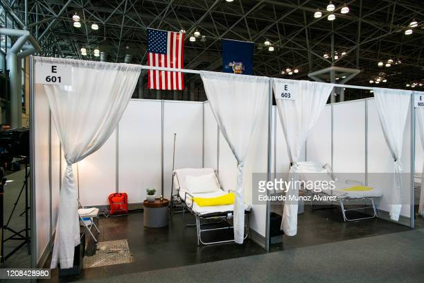 Hospital bed booths are set up at the Jacob K. Javits Convention Center which is being turned into a hospital to help fight coronavirus cases on...