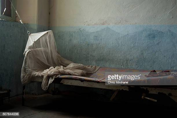 Hospital bed in a bombed out shelter used as a make shift hospital