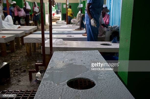 A hospital bed is covered in water as rain seeped through the roof of a ward full of cholera patients at the Charles Colimon hospital in Petite...