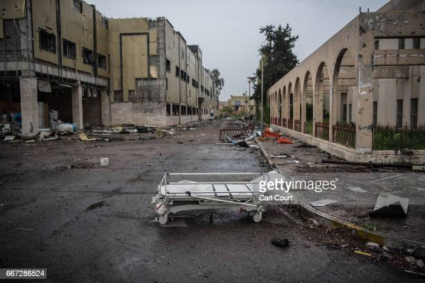 A hospital bed is left in the ruins of AlSalam Hospital after the building was destroyed during fighting between Iraqi forces and Islamic State on...