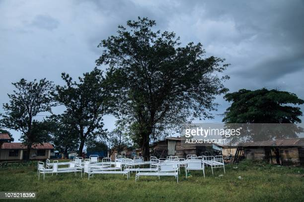TOPSHOT Hospital beds are stored outside ransacked tents by demonstrators by the Ebola transit centre in Beni following a demonstration against the...