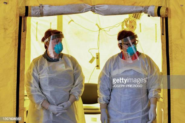 Hospital clinicians work to test patients for the coronavirus Covid19 at NewtonWellesley Hospital in Newton Massachusetts on March 18 as the hospital...