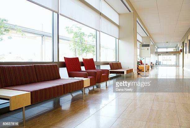 hospital corridor and waiting area - medical building stock pictures, royalty-free photos & images