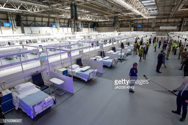 Hospital cubicles with beds and chairs are pictured during the official opening of the NHS Nightingale Hospital Birmingham setup inside the National...