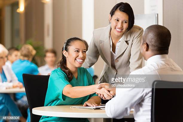 hospital employee and nurse at job interview - recruitment stock pictures, royalty-free photos & images