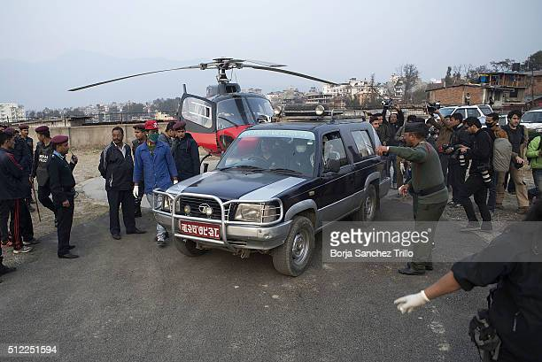 Hospital employees carry the bodies of Nepalese plane crash victims by 4WD to the Teaching Hospital Morgue after rescue team brought them by...
