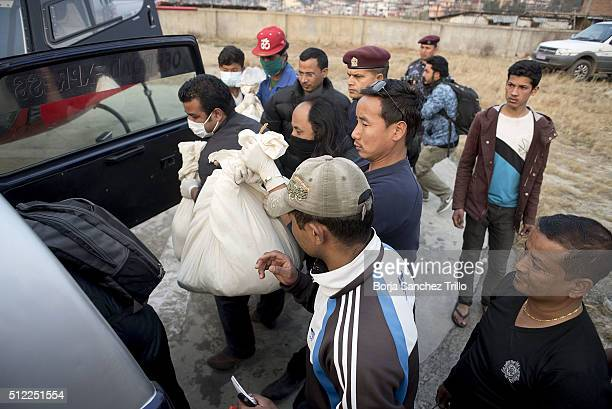 Hospital employees put inside a jeep the bodies of the crew members and one passenger victim of the Nepalese plane crash to transport them to the...