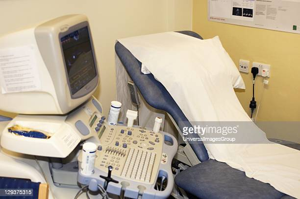 Hospital examination room equipped with bed computer and tray of phials