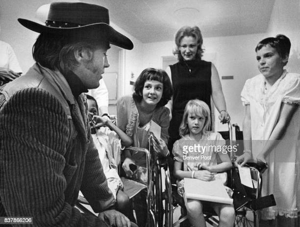 Hospital Goes Western Clu Gulager who formerly played in the television series The Virginian top photo entertains patients at Children's Hospital...