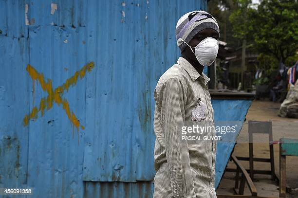 Hospital guard waits to greet patients some suspected of suffering from the Ebola virus in Monrovia on September 25 2014 World leaders were asked to...