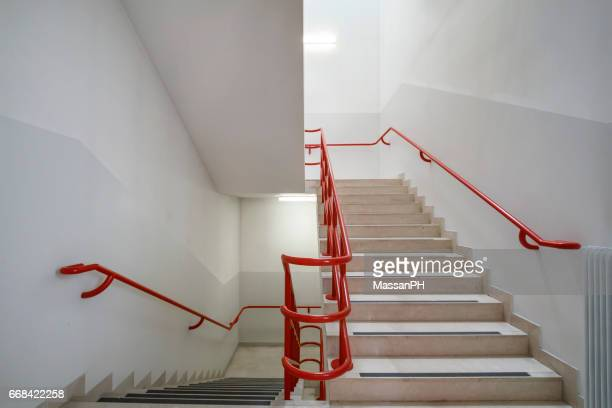 Hospital internal staircase with red handrails
