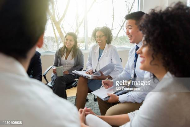 hospital management meets with healthcare professionals - group of doctors stock pictures, royalty-free photos & images