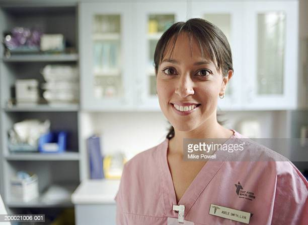 hospital nurse in pink uniform, portrait - name tag stock photos and pictures